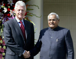 NEW DELHI, INDIA: Former US president Bill Clinton (L) shakes hands with Indian Prime Minister Atal Behari Vajpayee before a meeting in New Delhi, 21 November 2003. Clinton said the AIDS epidemic will never be stopped without affordable medicine, as he visited an Indian pharmaceutical giant taking part in his drive to provide cheaper treatment to poor countries. AFP PHOTO/RAVEENDRAN (Photo credit should read RAVEENDRAN/AFP/Getty Images)