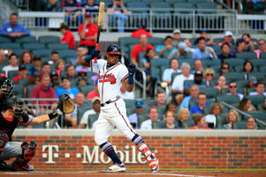 Ronald Acuna Jr. #13 of the Atlanta Braves is hit by the first pitch of the game against the Miami Marlins at SunTrust Park on August 15, 2018 in Atlanta, Georgia.
