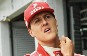 Michael Schumacher talking to the press at Silverstone in 1996.