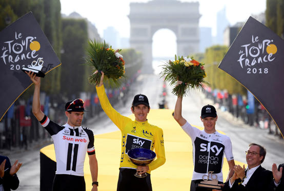 Slide 1 of 101: Cycling - Tour de France - The 116-km Stage 21 from Houilles to Paris Champs-Elysees - July 29, 2018 - Team Sky rider Geraint Thomas of Britain, wearing the overall leader's yellow jersey, Team Sunweb rider Tom Dumoulin of the Netherlands and Team Sky rider Chris Froome of Britain celebrate on the podium. Stephane Mantey/Pool via REUTERS      TPX IMAGES OF THE DAY