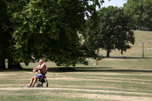 A man soaks up the sun in Regent's Park, London, Friday, July 27, 2018. Britain is experiencing a severe heatwave which has prompted its national weather service to issue an alert for people to 'stay out of the sun'. (AP Photo/Robert Stevens)