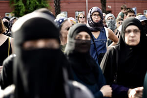 Women wearing niqab and headscarves take part in a demonstration on August 1, 2018, the first day of the implementation of the Danish face veil ban, in Copenhagen, Denmark. - Denmark's controversial ban on the Islamic full-face veil in public spaces came into force as women protested the new measure which fines anyone wearing the garment. Human rights campaigners have slammed the ban as a violation of women's rights, while supporters argue it enables better integration of Muslim immigrants into Danish society. (Photo by Mads Claus Rasmussen / Ritzau Scanpix / AFP) / Denmark OUT        (Photo credit should read MADS CLAUS RASMUSSEN/AFP/Getty Images)