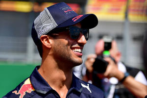 Red Bull's Australian driver Daniel Ricciardo smiles prior to the race of the Formula One Hungarian Grand Prix at the Hungaroring circuit in Mogyorod near Budapest, Hungary, on July 29, 2018. (Photo by ANDREJ ISAKOVIC / AFP)        (Photo credit should read ANDREJ ISAKOVIC/AFP/Getty Images)