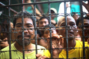 Filipino inmates remain in their cell at the North Cotabato District Jail in Kidapawan city, Cotabato Province, southern Philippines, after a massive jailbreak Wednesday, Jan. 4, 2017. In one of the country's largest jailbreaks in recent years, nearly 160 inmates escaped after suspected Muslim rebels attacked the jail before dawn Wednesday killing at least six people as pursuing government forces traded fire with gunmen, officials said. (AP Photo)