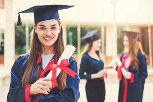 Young female students graduating from university