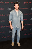NEW YORK, NY - AUGUST 08:  Designer John Varvatos and Musician/Actor Nick Jonas co-host launch party for their new fragrance collaboration JV x NJ.  (Photo by Kevin Mazur/Getty Images for Revlon)