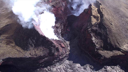 "In this Aug. 11, 2018 aerial photo provided by the United States Geological Survey shows diminished volcanic activity on Kilauea's lower East Rift Zone. Slowing activity at Hawaii's Kilauea volcano is prompting scientists to downgrade their alert level for the mountain. The U.S. Geological Survey said Friday, Aug. 17, it issued a ""watch"" for Kilauea's ground hazards; that's down from a ""warning."" Geologists say lava mostly stopped flowing on Aug. 6. (USGS via AP)"
