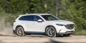 a car parked on the side of a road: The Mazda CX-9 finished first in our mid-size crossover comparison.