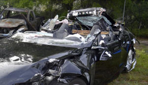 In this photo provided by the National Transportation Safety Board via the Florida Highway Patrol, a Tesla Model S that was being driven by Joshua Brown, who was killed when the Tesla sedan crashed while in self-driving mode on May 7, 2016. A source tells The Associated Press that U.S. safety regulators are ending an investigation into a fatal crash involving electric car maker Tesla Motors' Autopilot system without a recall. The National Highway Traffic Safety Administration scheduled a call Thursday, Jan. 19, 2017, about the investigation. (NTSB via Florida Highway Patrol via AP, File)