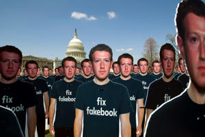 "Life-sized cutouts depicting Facebook CEO Mark Zuckerberg wearing ""Fix Fakebook"" T-shirts are displayed by advocacy group, Avaaz, on the South East Lawn of the Capitol on Capitol Hill in Washington, Tuesday, April 10, 2018, ahead of Zuckerberg's appearance before a Senate Judiciary and Commerce Committees joint hearing. (AP Photo/Jose Luis Magana)"