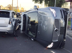 Photo provided by the Tempe Police Department shows an Uber self-driving SUV that flipped on its side in a collision in Tempe, Ariz. The crash serves as a stark reminder of the challenges surrounding autonomous vehicles in Arizona. (Tempe Police Department via AP)