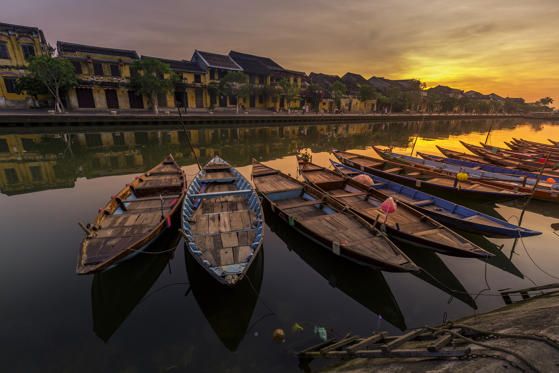 Slide 2 of 28: Sunrise at Hoi An Vietnam