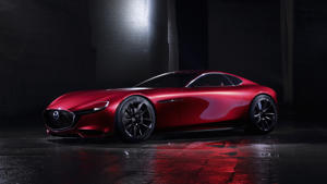 a red car parked on the side of a road: Mazda RX-Vision Concept