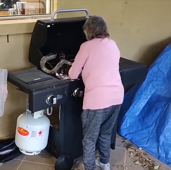 Grandma removes snakes from grill with bare hands