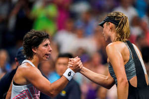 Spain's Carla Suarez Navarro (L) shakes hands with Russia's Maria Sharapova after winning their 2018 US Open Women's Singles tennis match at the USTA Billie Jean King National Tennis Center in New York on September 3, 2018. (Photo by EDUARDO MUNOZ ALVAREZ / AFP) (Photo credit should read EDUARDO MUNOZ ALVAREZ/AFP/Getty Images)