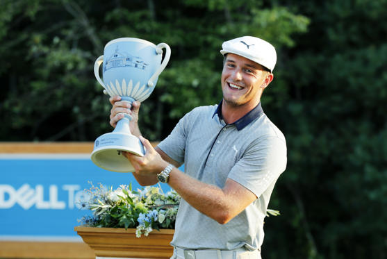 Slide 2 of 89: NORTON, MA - SEPTEMBER 03: Bryson DeChambeau of the United States hoists the Wedgewood Trophy after winning the Dell Technologies Championship on September 3, 2018, at TPC Boston in Norton, Massachusetts. (Photo by Fred Kfoury III/Icon Sportswire via Getty Images)