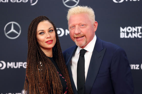 Slide 2 of 55: Former German tennis player Boris Becker (R) and his wife Lilly (L) pose as they arrive for the 2018 Laureus World Sports Awards ceremony at the Sporting Monte-Carlo complex in Monaco on February 27, 2018. / AFP PHOTO / VALERY HACHE        (Photo credit should read VALERY HACHE/AFP/Getty Images)