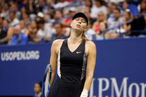 Maria Sharapova, of Russia, reacts after losing a point to Carla Suarez Navarro, of Spain, during the fourth round of the U.S. Open tennis tournament, Monday, Sept. 3, 2018, in New York. (AP Photo/Jason DeCrow)