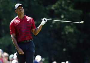 Tiger Woods reacts to his shot from the fairway on the fifth hole during the final round of the Dell Technologies Championship golf tournament at TPC Boston in Norton, Mass., Monday, Sept. 3, 2018. (AP Photo/Michael Dwyer)