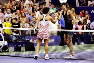 NEW YORK, USA - SEPTEMBER 3: Carla Suarez Navarro (L) of Spain and Maria Sharapova (R) of Russia greet each other following their women's single match during US Open 2018 tournament in New York, United States on September 3, 2018.  (Photo by Mohammed Elshamy/Anadolu Agency/Getty Images)