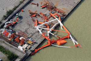 An aerial view from a Jiji Press helicopter shows a crane that toppled due to strong winds in Nishinomiya city, Hyogo prefecture on September 5, 2018, after typhoon Jebi hit the west coast of Japan. - The toll in the most powerful typhoon to hit Japan in a quarter century rose on September 5 to nine, with thousands stranded at a major airport because of storm damage. (Photo by JIJI PRESS / JIJI PRESS / AFP) / Japan OUT        (Photo credit should read JIJI PRESS/AFP/Getty Images)