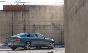 a car parked on the side of a building: Volvo S90 T6 Inscription Is an Elegant Alternative to the Luxury Status Quo