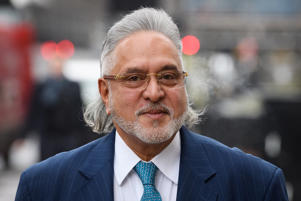 LONDON, ENGLAND - JANUARY 11:  F1 Force India team boss Vijay Mallya walks through the press as he arrives at The City of Westminster Magistrates Court on January 11, 2018 in London, England.  The Indian liquor tycoon is wanted in India on charges of fraud and money laundering.  (Photo by Leon Neal/Getty Images)