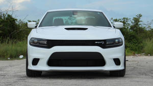 a white car parked in a parking lot: 2018 Dodge Charger Hellcat: Review