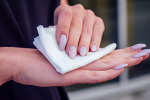Woman using paper towel
