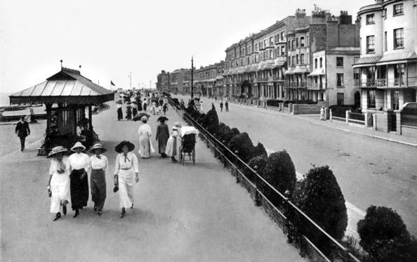 Slide 2 of 37: The promenade, West Worthing, West Sussex, early 20th century. (Photo by The Print Collector/Print Collector/Getty Images)