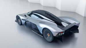 a pair of black car: Aston Martin Valkyrie with near-production body