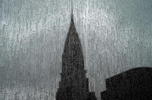 TOPSHOT - The Chrysler Building is seen through a rain covered high-rise window on August 13, 2018. - The Chrysler Building is an Art Decostyle skyscraper located on the East Side of Midtown Manhattan in New York City and one of the city landmarks. (Photo by TIMOTHY A. CLARY / AFP)        (Photo credit should read TIMOTHY A. CLARY/AFP/Getty Images)