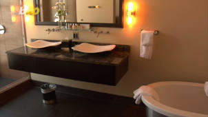 a white sink sitting under a mirror: 5 Things to Double-Check in Your Hotel Room
