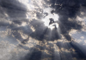 Dramatic clouds with sunbeams formed the face of Jesus Christ
