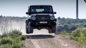 a truck driving down a dirt road: 2019 Mercedes-AMG G63