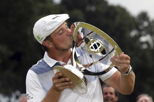 Bryson DeChambeau kisses the trophy after winning the Northern Trust golf tournament, Sunday, Aug. 26, 2018, in Paramus, N.J. (AP Photo/Mel Evans)