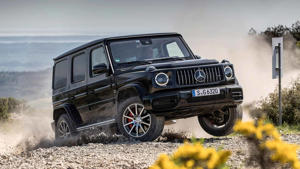 a car parked on a dirt road: Mercedes-AMG G63