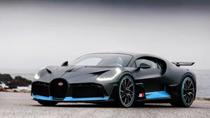a car parked on the side of a road: Bugatti Divo