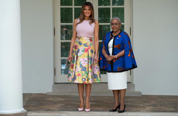 Slide 3 of 161: US First Lady Melania Trump walks with Margaret Kenyatta (R), wife of the Kenyan President, as she arrives at the White House in Washington, DC, August 27, 2018. (Photo by SAUL LOEB / AFP)        (Photo credit should read SAUL LOEB/AFP/Getty Images)