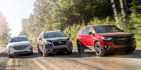 To see how Subaru's new Ascent crossover stacks up against its three-row-SUV peers, we gather the best and newest entries from the mid-size segment and drive them north to Canada.