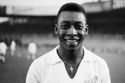 Brazilian striker Pelé, wearing his Santos jersey, smiles before playing a friendly soccer match with his club against the French club of 'Racing', on June 13, 1961 in Colombes, in the suburbs of Paris.   Pelé score one goal as Santos won 5-4. Widely considered to be the greatest player in soccer history, Pelé scored 1282 goals in his career and won three World Cup titles with Brazil (1958 in Sweden, 1962 in Chile, 1970 in Mexico). / AFP PHOTO / -        (Photo credit should read -/AFP/Getty Images)