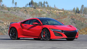 a red car parked on the side of a road: 2017 Acura NSX: Review