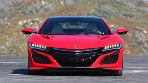 a black and red car on a road: 2017 Acura NSX: Review