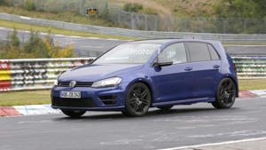 a car parked on the side of a road: 2018 VW Golf R420 (not confirmed) spy photo
