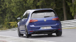 a car parked on the side of a road: Possible 2018 VW Golf R420 spy photos