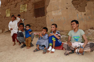 Boys including some of those who survived last month's air strike that killed dozens of people including children, sit outside a house in Saada, Yemen September 5, 2018. Picture taken September 5, 2018. REUTERS/Naif Rahma