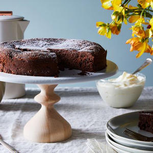 a cake sitting on top of a table: A Fancy French Chocolate Cake You'd Never Guess Is One-Bowl