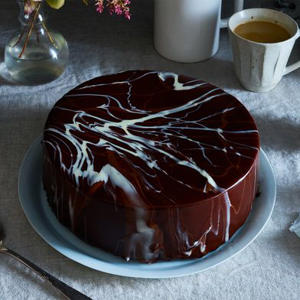 a cup of coffee on a table: Meet Salvador Dalí–Style Chocolate Glaze (It's Easier Than It Looks)