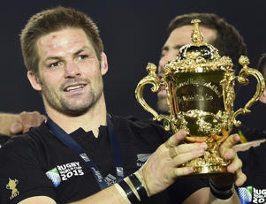 New Zealand's flanker and captain Richie McCaw   holds the Webb Ellis Cup as he celebrates with teammates after winning the final match of the 2015 Rugby World Cup between New Zealand and Australia