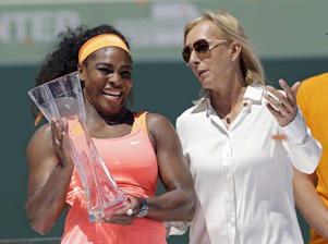FILE - This is a Saturday, April 4, 2015, file photo of former tennis star Martina Navratilova, right,  as she poses with Serena Williams